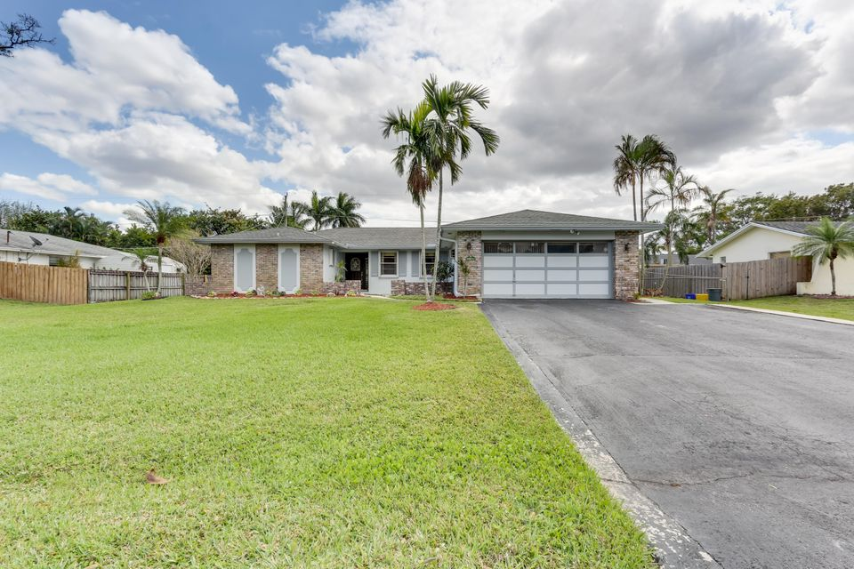 55 W Plumosa Lane , Lake Worth FL 33467 is listed for sale as MLS Listing RX-10312936 30 photos