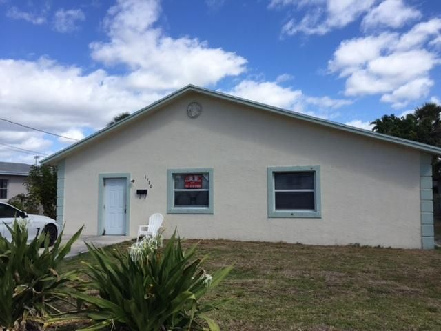 1720 W 13th Street is listed as MLS Listing RX-10319245 with 15 pictures