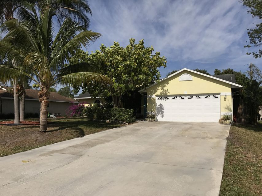 1912 SW Lennox Street is listed as MLS Listing RX-10319775 with 49 pictures