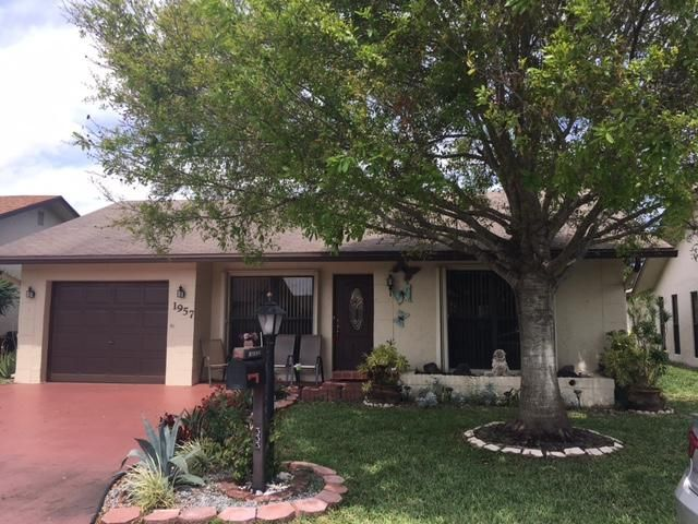1957 SW 16th Place is listed as MLS Listing RX-10320074 with 25 pictures