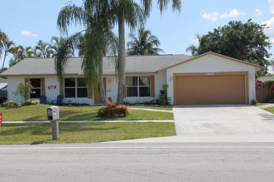 408 La Mancha Avenue Royal Palm Beach, FL 33411
