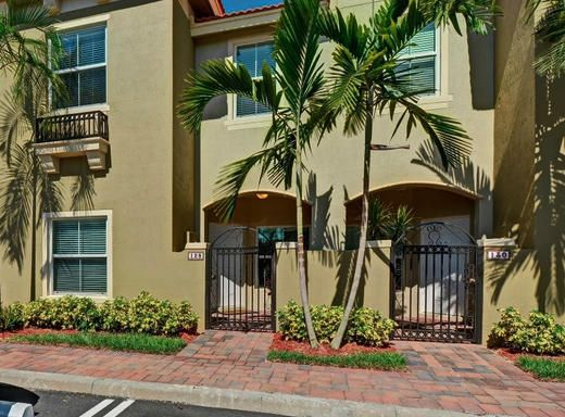 Updated townhome in gated community with lake views, 9-foot ceilings and walk-in closets!  Quiet, convenient and pet-friendly.  Minutes from downtown Delray Beach and Renaissance Commons.