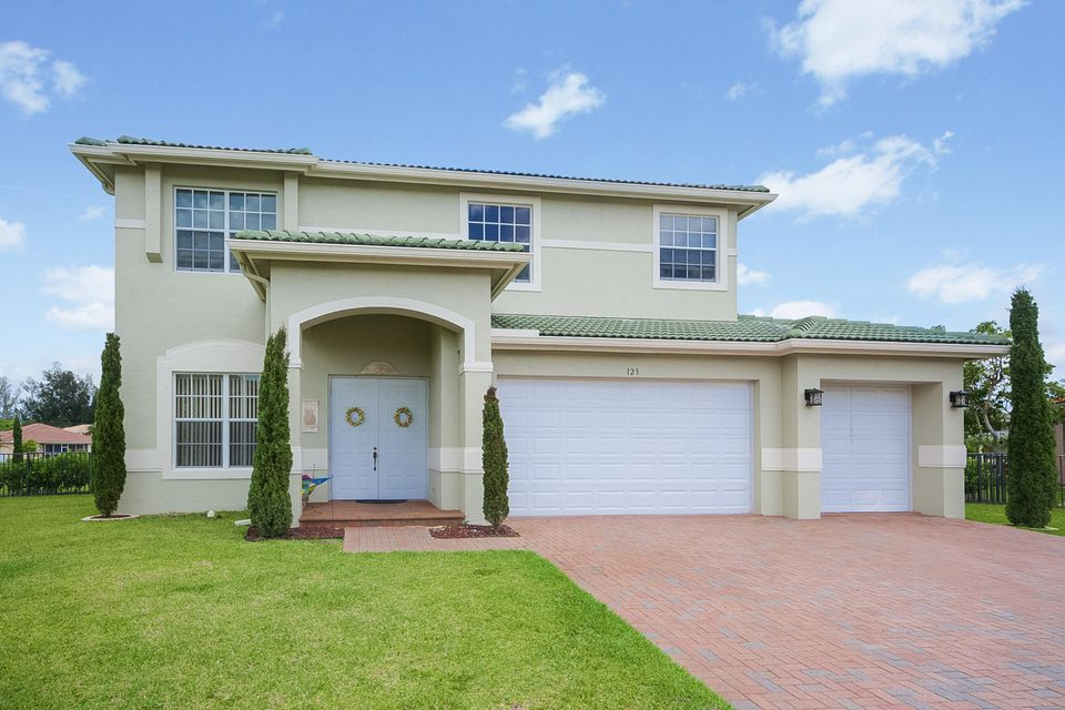 Single Family Home for Sale at 123 Isola Circle Royal Palm Beach, Florida 33411 United States