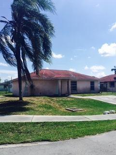 302 Amaryllis Court, Pahokee, FL 33476