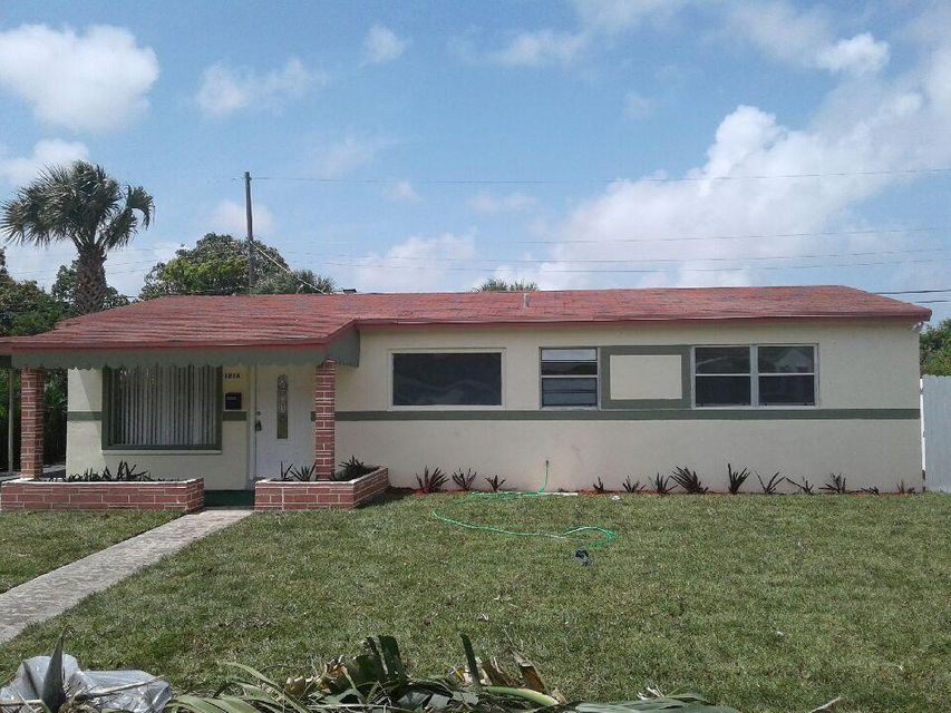 1218 W 26th Street is listed as MLS Listing RX-10337842 with 7 pictures