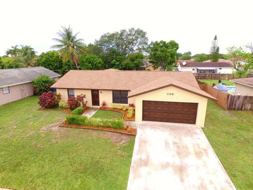 286 La Mancha Ave Royal Palm Beach, FL 33411