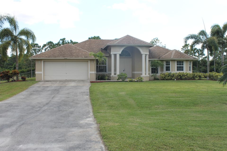 Maison unifamiliale pour l Vente à 12858 N 61st Street N 12858 N 61st Street N West Palm Beach, Florida 33412 États-Unis