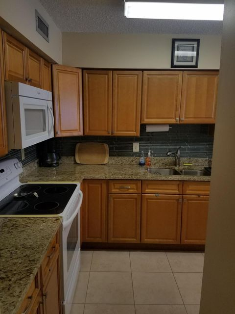 Beautiful first floor corner unit that is tastefully furnished in an active adult community in central Delray! Lovely florida room brings a ton of light into the home. No carpet, all tile. Upgraded kitchen with granite countertops and new appliances! Flat screen tv's in every room. Owners are flexible on removing some of the furniture. Most of it is new! The community offers a heated pool, hot tub, tennis facility with pro on staff, 2 exercise rooms, and pool side snack bar! There are many activities and clubs to join as well! Close to beaches and dining!