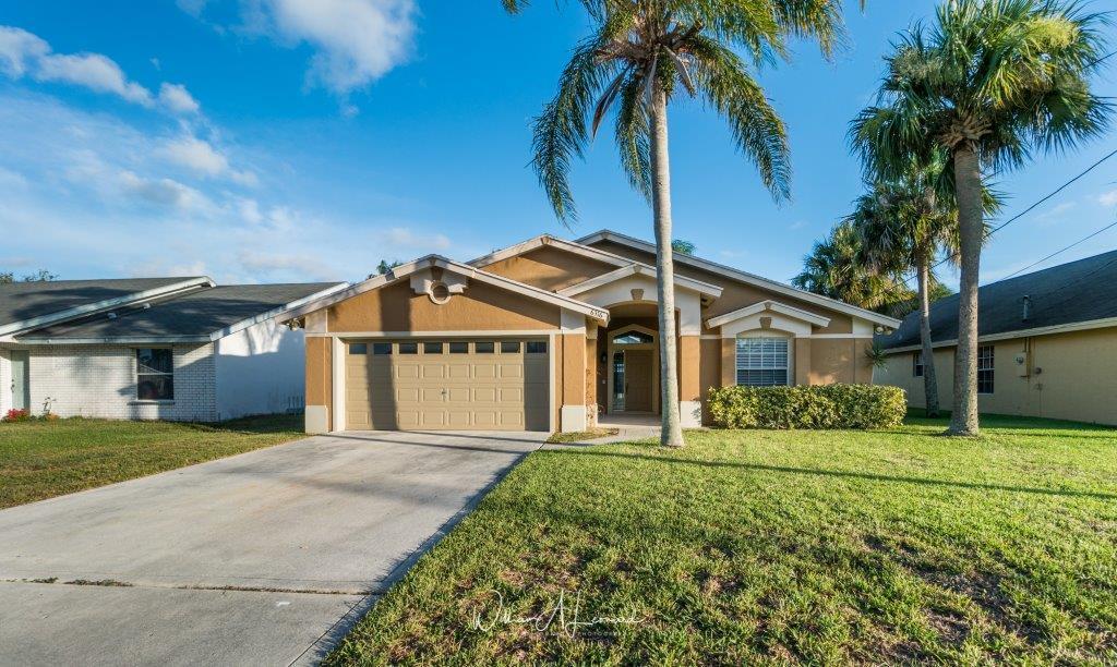 Maison unifamiliale pour l Vente à 6316 Ungerer Street Jupiter, Florida 33458 États-Unis