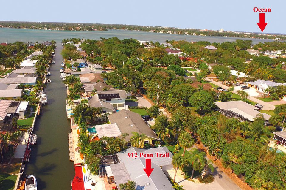Boaters welcomed in this Key West style home located on a deep-water canal with ocean access and only minutes to the Jupiter Inlet. Enjoy waterfront living at its finest, this 3 bedroom, 2 bath home is nestled just off the wide waters of the Loxahatchee River and turquoise, clear high tide waters. Take your boat for the day to play on the sandbar, just minutes from your home or take a sunset cruise to one of the many wonderful, waterfront, dining establishments. You will feel like you are on an indefinite vacation. This home features a renovated kitchen, with wood cabinetry, stainless steel appliances (new oven/range) and granite countertops. Split floor plan with a master suite that has an updated master bath with separate tub and shower, private sliding glass doors that lead out to private area, perfect for hot tub or sunbathing. Private dock, screened in patio area with heated salt water pool and fenced in backyard. Nestled on a quiet street and conveniently located to great restaurants, shopping, public library, public transportation, golf, marinas, all water sports and pristine beaches.