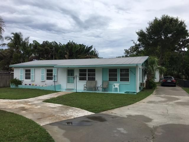 This is a truly unique opportunity in Hobe Sound. For sale for the first time in 45 plus years, 8864 SE Jardin offers a concrete block main house, and fully functional separate guest house. Use the guest house for family, friends, or excellent rental income. The homes are metered separately. The main house features a metal roof and a new air conditioner. 3 beds, an office/den, and multiple living areas provide plenty of space. The guest house features an open plan, high ceilings, full kitchen, washer/dryer, central A/C and a back patio. There are two bedrooms, a living room, and 1 full bath in the guest house (built 1997). A shed on property offers extra storage. SE Jardin is a dead-end road located just off Gomez Rd only minutes to Hobe Sound beach and great local restaurants.