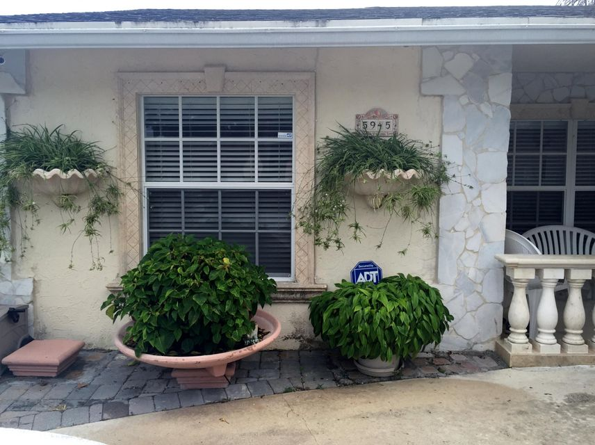5945  Lincoln Circle is listed as MLS Listing RX-10352399 with 23 pictures