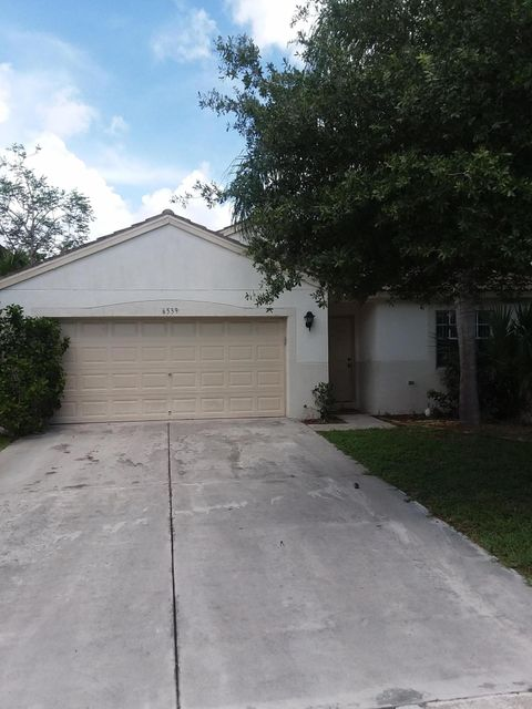Casa Unifamiliar por un Venta en 6539 Rainwood Cove Lane Lake Worth, Florida 33463 Estados Unidos