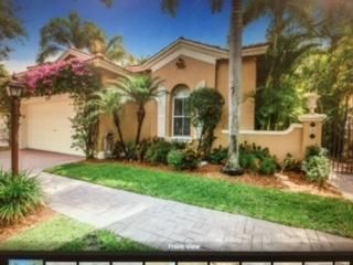 Casa Unifamiliar por un Venta en 5761 NW 122nd Way Coral Springs, Florida 33076 Estados Unidos