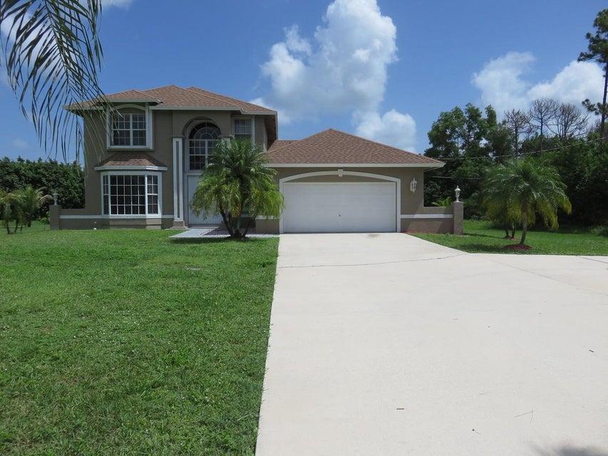 Maison unifamiliale pour l Vente à 12585 73rd Court N 12585 73rd Court N West Palm Beach, Florida 33412 États-Unis