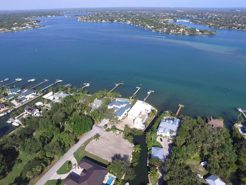 RARE!  ONE LOT from RIVER and BRIGHT BLUE WATER! Water Front Apx 170' on Private Canal with Private Dock.  Lot INCLUDES the canal. Lot is cleared and READY to build your Dream Home. Capture VIEWS of the BRIGHT BLUE water.  Added bonus of Park Like Setting across the street.  Quiet and Upscale Cul de Sac in sought after school district.  Survey and Soil Test are available.