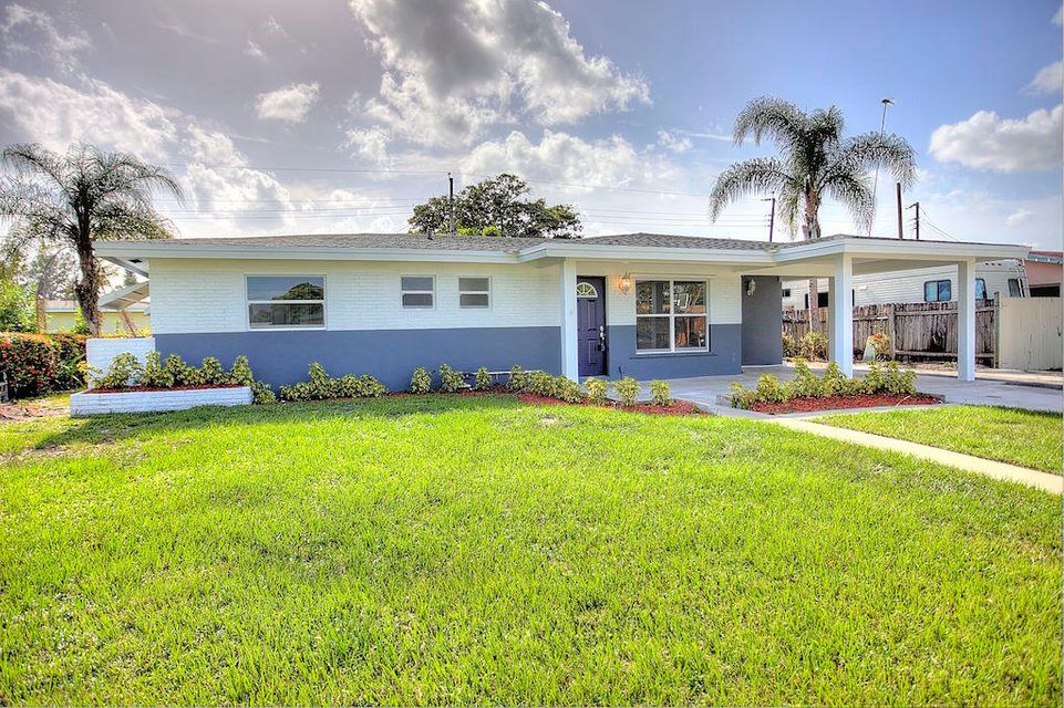 COMPLETELY updated home in desirable West Palm Beach location. This home is like new. 2017 updates include NEW roof, NEW windows, NEW A/C system, NEW floors, NEW hot water heater, NEW kitchen, NEW appliances, NEW bathrooms, NEW lighting, and fresh paint inside and out! Nothing in this home was left untouched. Kitchen features white shaker cabinets, granite counter tops, high-hat lighting, and brand new appliances. Both bathrooms have been completely modernized. Ceramic wood-look tile throughout most of the home, and new laminate in other portions. This modernized ''Old-Florida'' home is built extremely solid and offers over 1,700 sq feet of air-conditioned space. One-car carport and indoor laundry add value to this Cresthaven property. Come move right in, and make this home while it lasts.