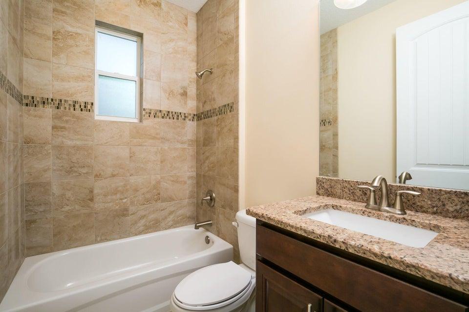 Additional photo for property listing at 1229 SW Ermine Av Avenue  Port St. Lucie, Florida 34953 Estados Unidos