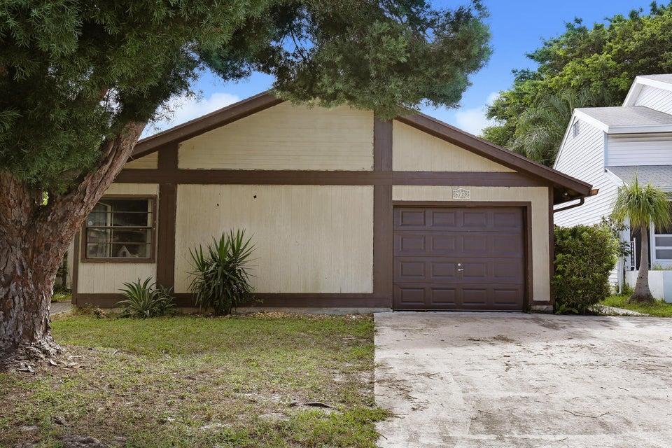 Casa Unifamiliar por un Venta en 4720 Brook Drive 4720 Brook Drive West Palm Beach, Florida 33417 Estados Unidos