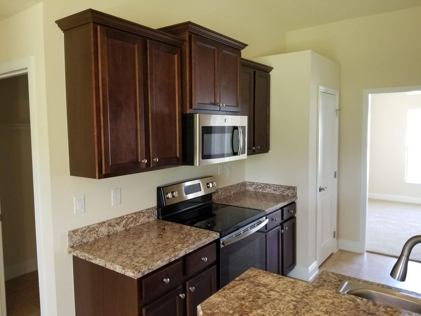 PORT ST LUCIE-SECTION 46- FIRST REPLAT BLK 3149 LOT 39 (MAP 33/13NA) (OR 2709-427)