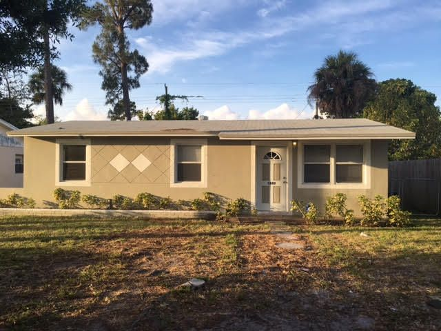 Casa Unifamiliar por un Venta en 5840 Papaya Road 5840 Papaya Road West Palm Beach, Florida 33413 Estados Unidos