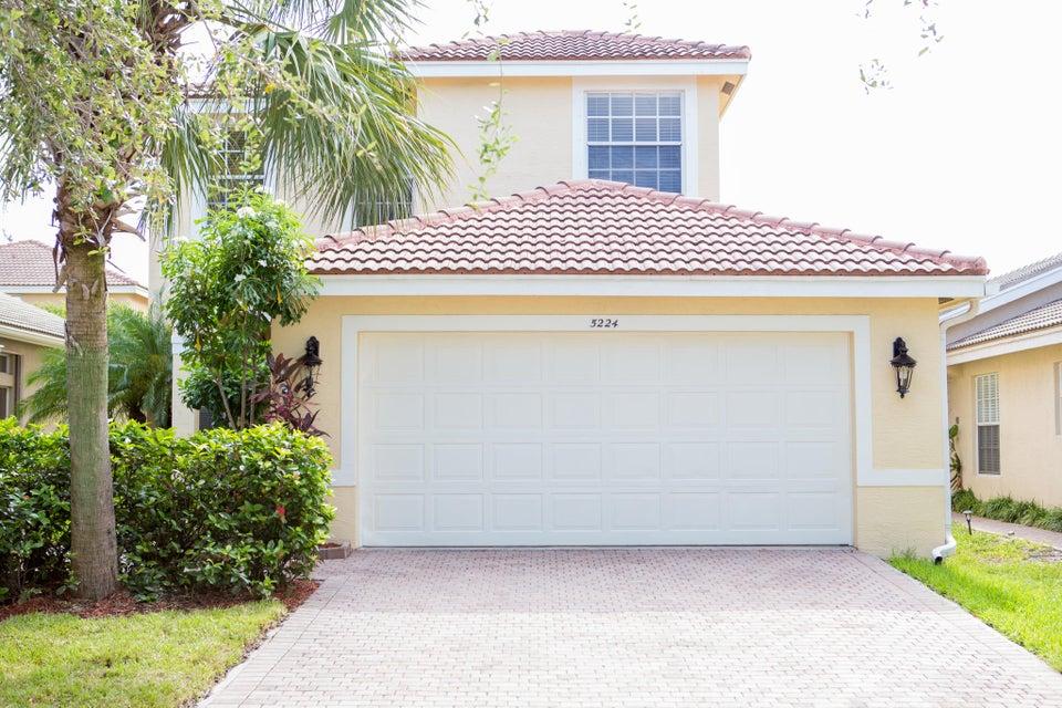 Casa Unifamiliar por un Venta en 5224 Rising Comet Lane 5224 Rising Comet Lane Greenacres, Florida 33463 Estados Unidos