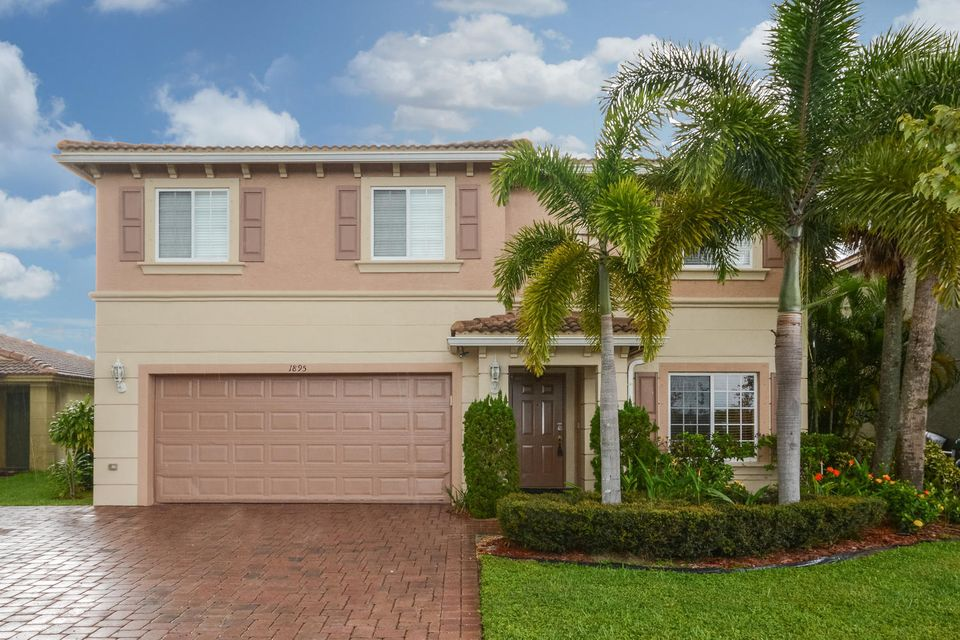 1895 SW Newport Isles Boulevard is listed as MLS Listing RX-10365307 with 25 pictures