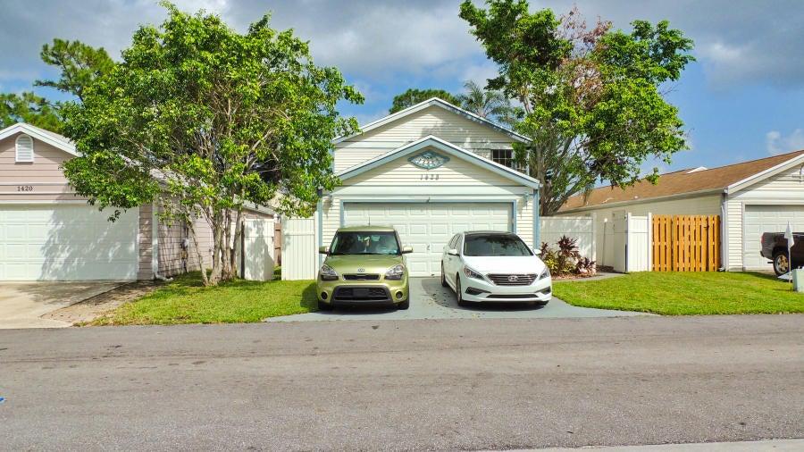1428 Blue Clover Lane  West Palm Beach, FL 33415