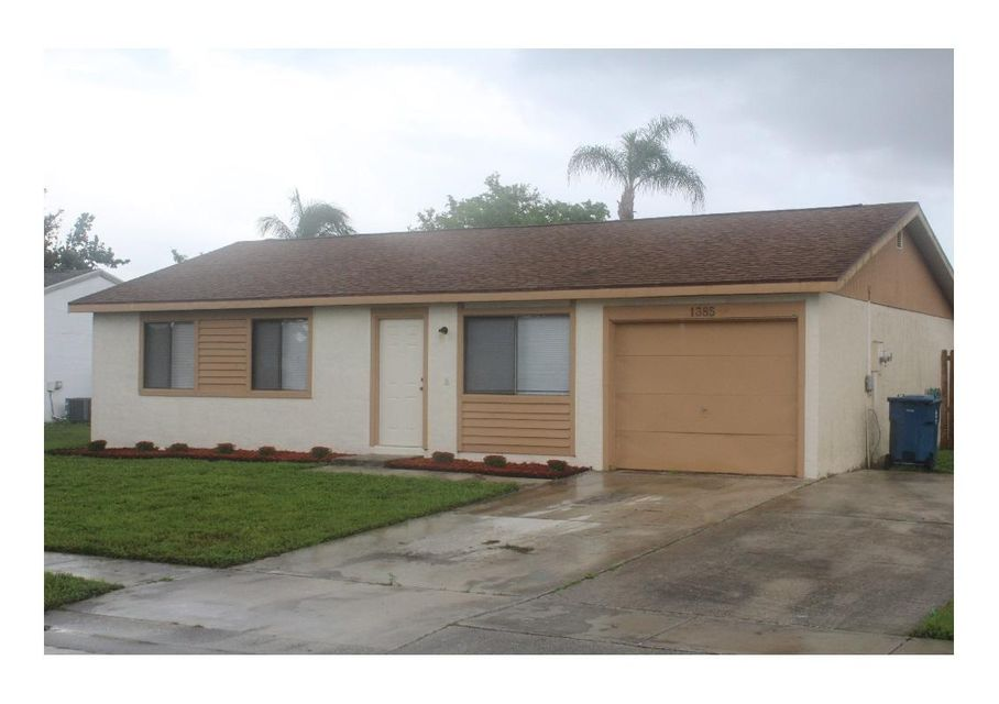 Home for sale in COUNTERPOINT ESTATES 12 Royal Palm Beach Florida