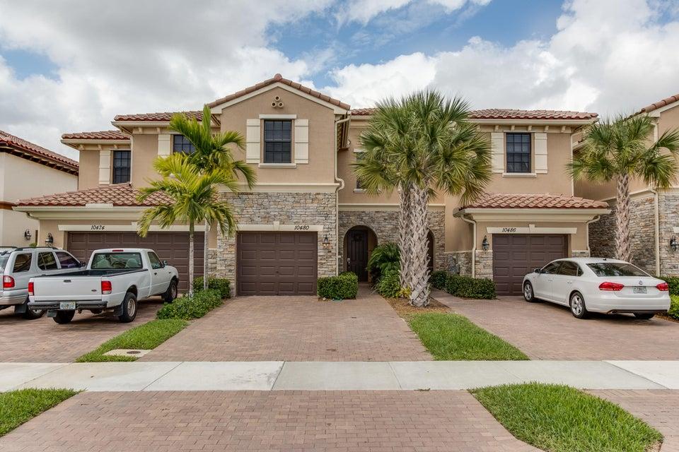 Maison accolée pour l Vente à 10480 Wellington Parc Drive 10480 Wellington Parc Drive Wellington, Florida 33449 États-Unis