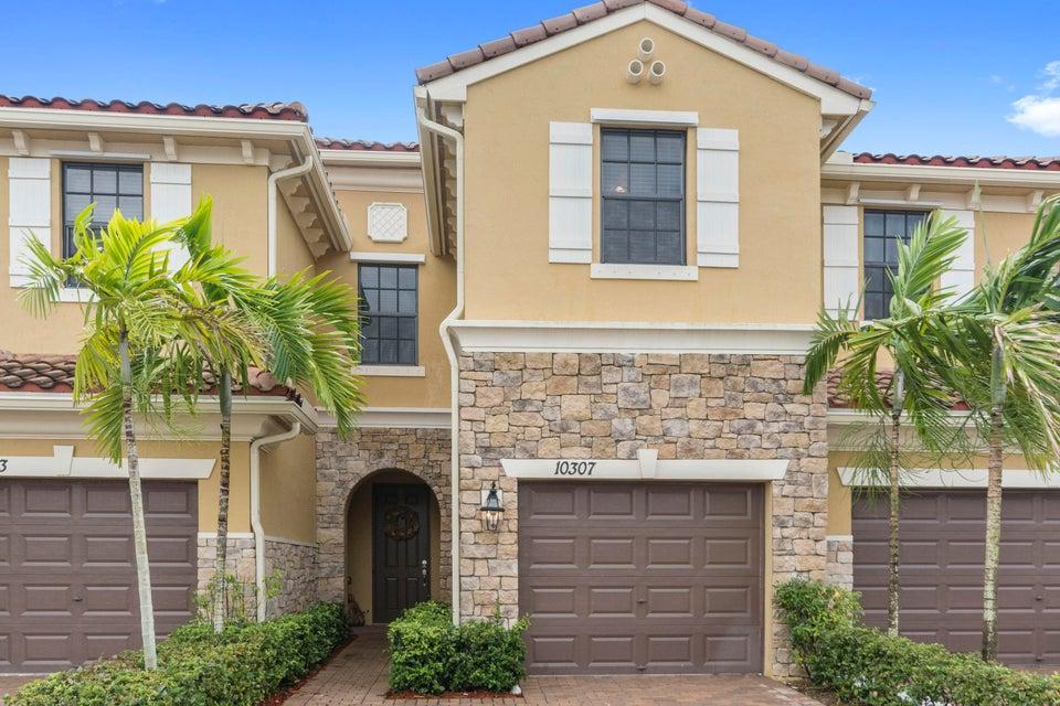 Maison accolée pour l Vente à 10307 Wellington Parc Drive 10307 Wellington Parc Drive Wellington, Florida 33449 États-Unis