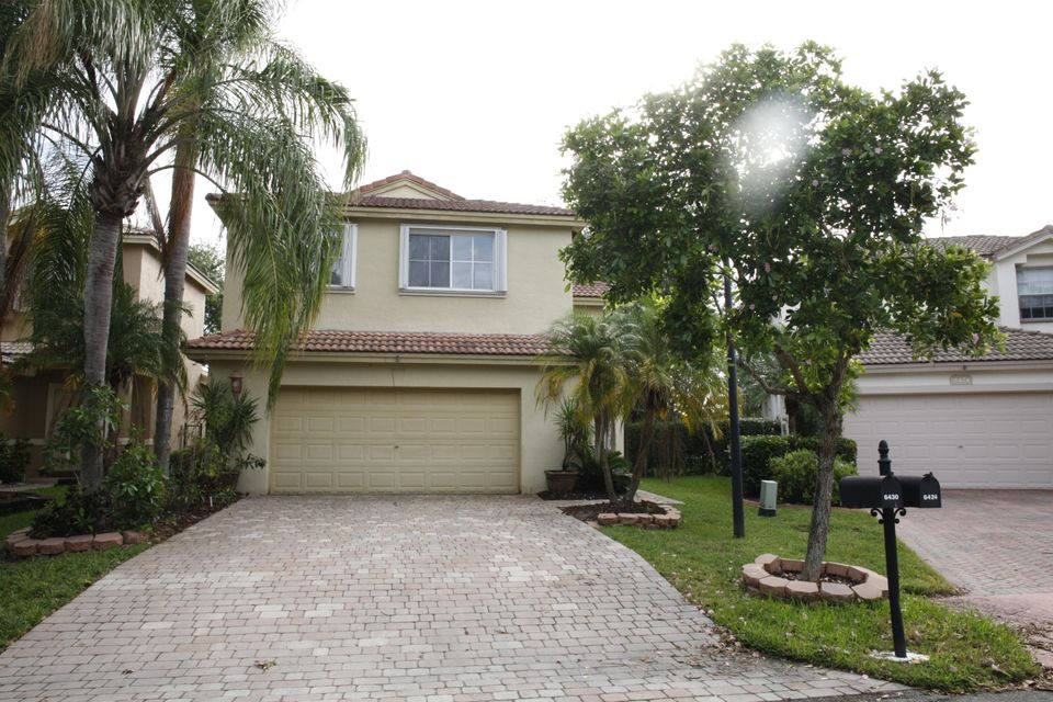 واحد منزل الأسرة للـ Sale في 6430 Egret Avenue 6430 Egret Avenue Coconut Creek, Florida 33073 United States