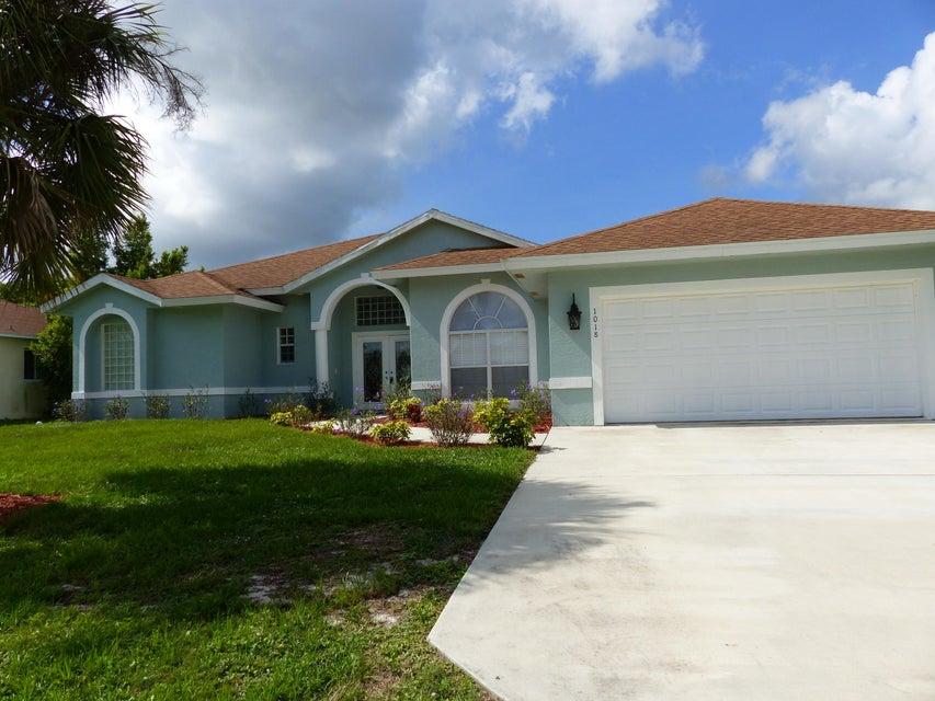 واحد منزل الأسرة للـ Sale في 1018 SW Dubuque Avenue 1018 SW Dubuque Avenue Port St. Lucie, Florida 34953 United States