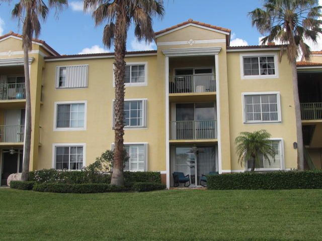 135  Yacht Club Way is listed as MLS Listing RX-10381330 with 35 pictures