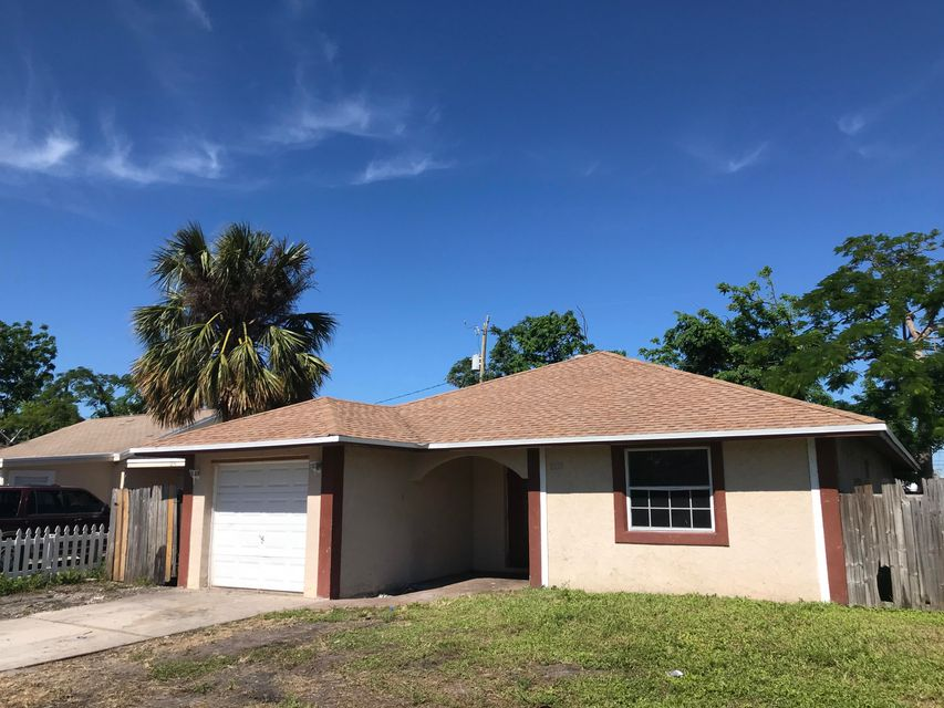 1230 W 25th Street , Riviera Beach FL 33404 is listed for sale as MLS Listing RX-10354956 13 photos