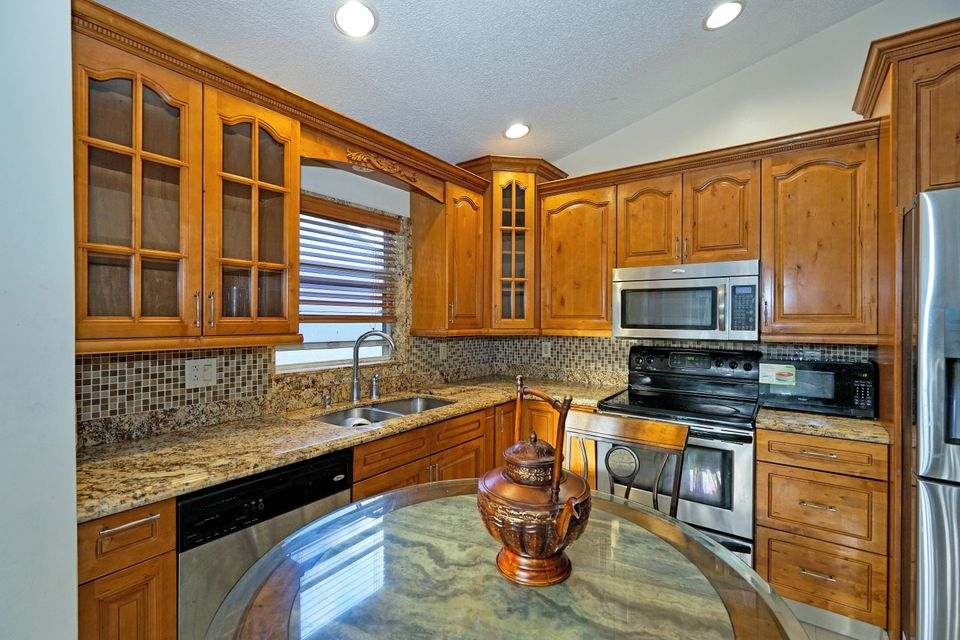 12781  Meadowbreeze Drive is listed as MLS Listing RX-10382363 with 31 pictures