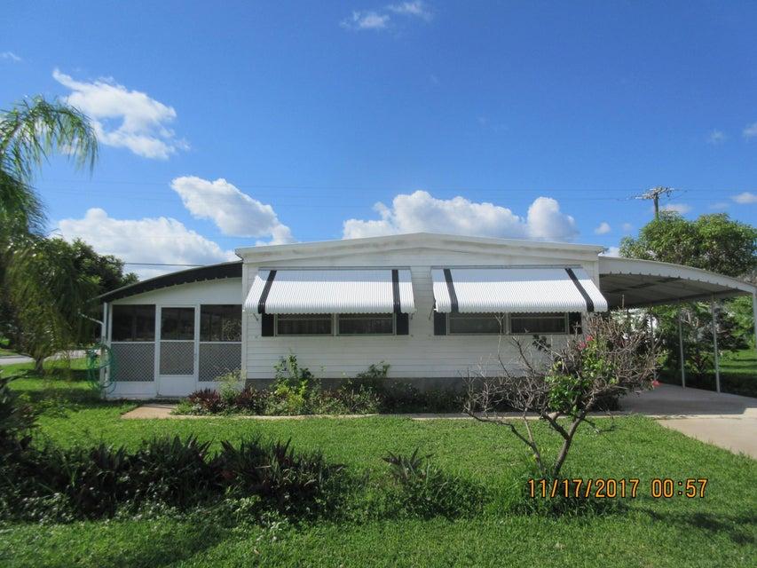Mobile / Manufactured for Sale at 8162 SE Skylark Avenue 8162 SE Skylark Avenue Hobe Sound, Florida 33455 United States