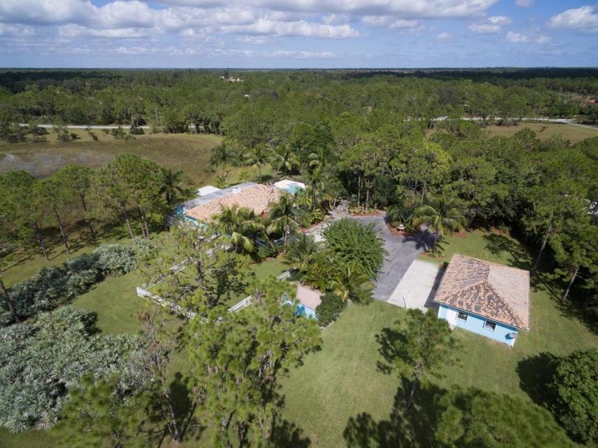 2914 SE Ranch Acres Circle , Jupiter FL 33478 is listed for sale as MLS Listing RX-10390694 38 photos