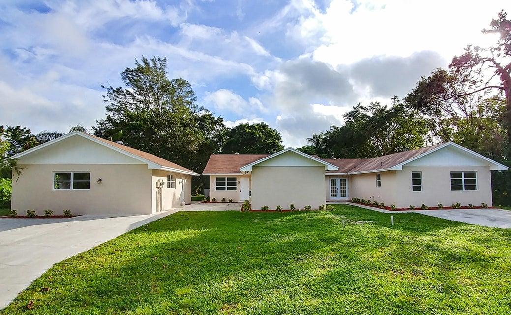 Home for sale in Acreage & Unrec Royal Palm Beach Florida