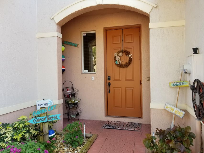 6036 Seminole Gardens Circle , Palm Beach Gardens FL 33418 is listed for sale as MLS Listing RX-10392430 36 photos