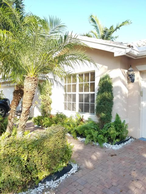 5200 Rising Comet Lane , Greenacres FL 33463 is listed for sale as MLS Listing RX-10393644 21 photos