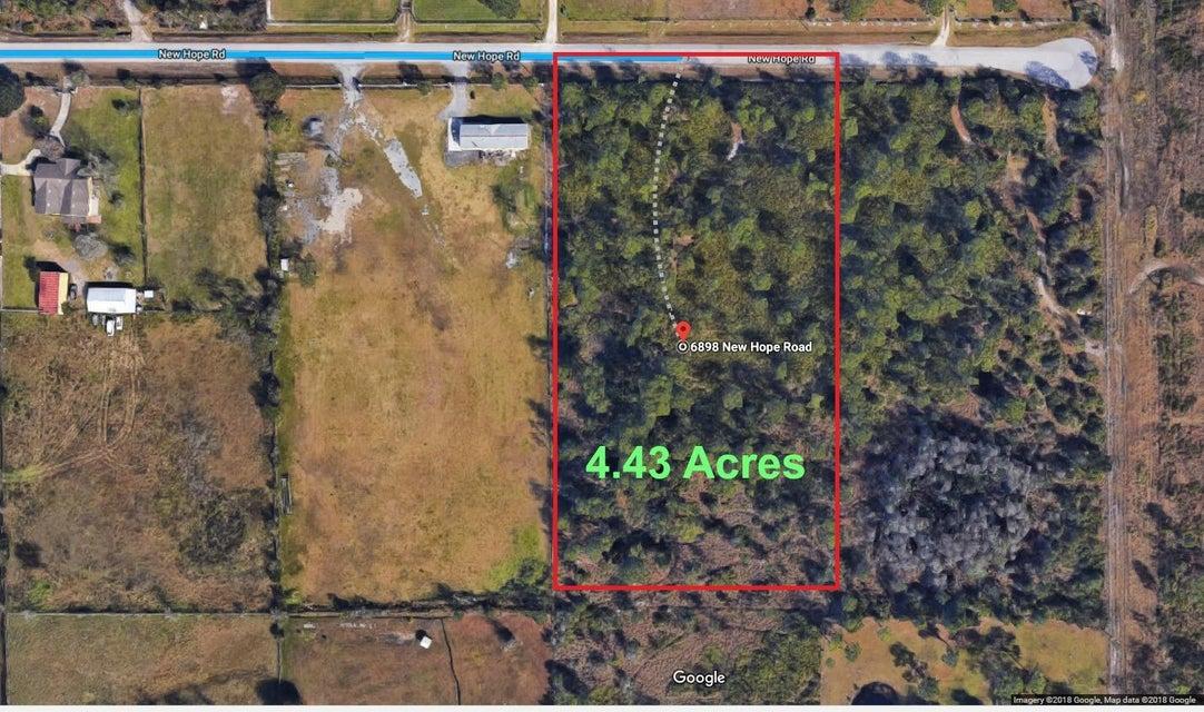 Casa Unifamiliar por un Venta en 6898 New Hope Road 6898 New Hope Road Orlando, Florida 32824 Estados Unidos