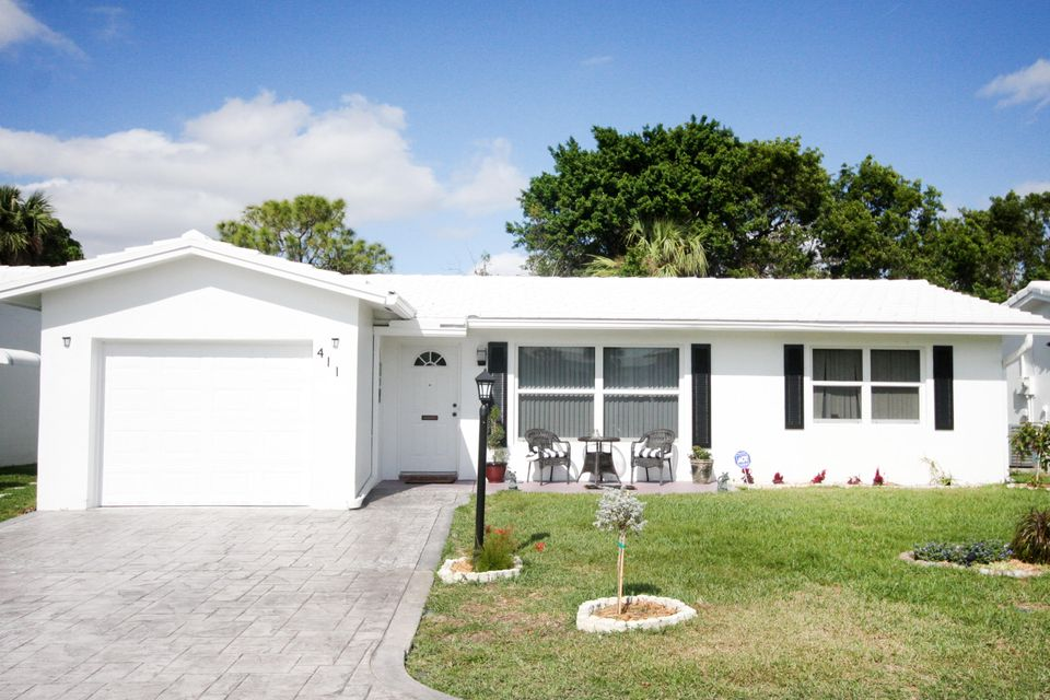 411 NW 26th Court is listed as MLS Listing RX-10396627 with 28 pictures