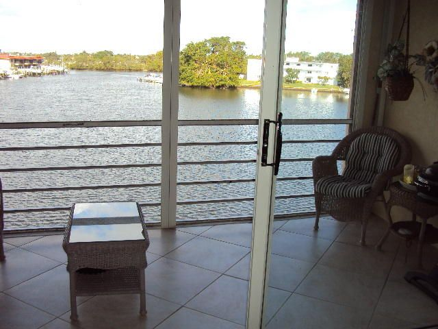 313  Lake Circle #311  & Dock  is listed as MLS Listing RX-10397230 with 28 pictures