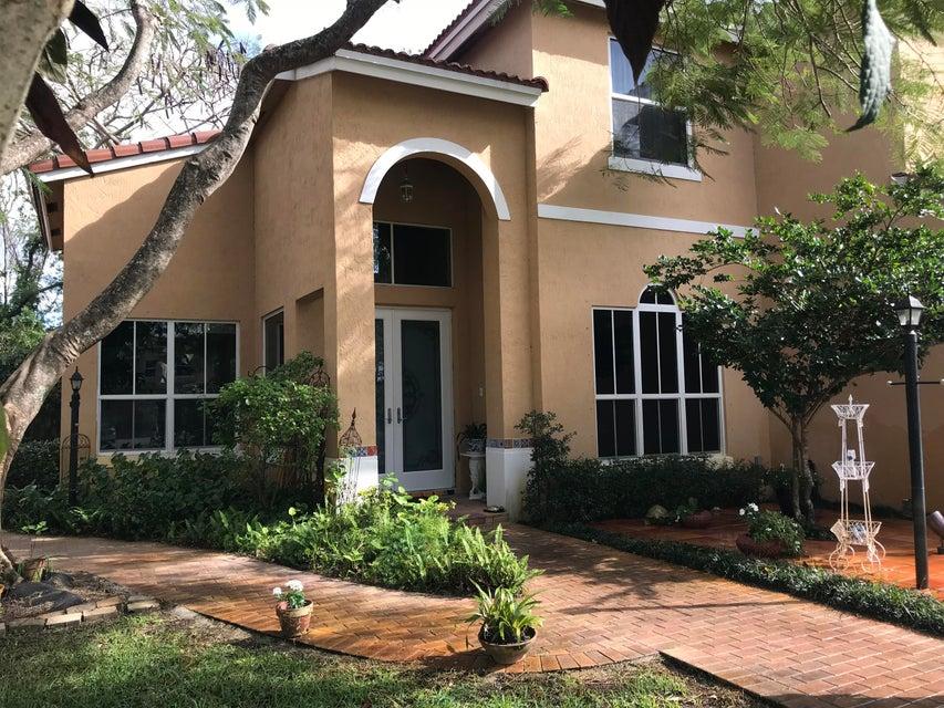 Частный односемейный дом для того Продажа на 4480 NW 42 Terrace 4480 NW 42 Terrace Coconut Creek, Флорида 33073 Соединенные Штаты