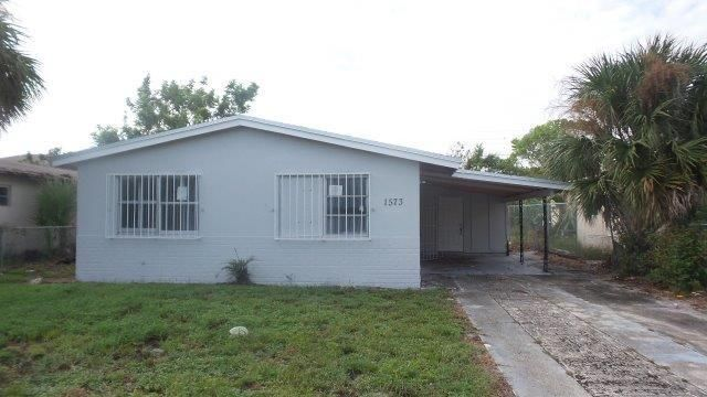 1573 W 34th Street , Riviera Beach FL 33404 is listed for sale as MLS Listing RX-10397955 8 photos