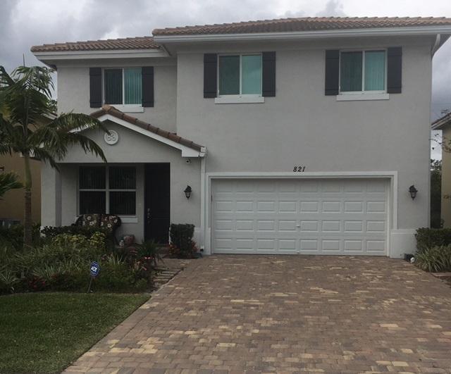 Casa Unifamiliar por un Venta en 821 Palm Tree Lane 821 Palm Tree Lane Haverhill, Florida 33415 Estados Unidos