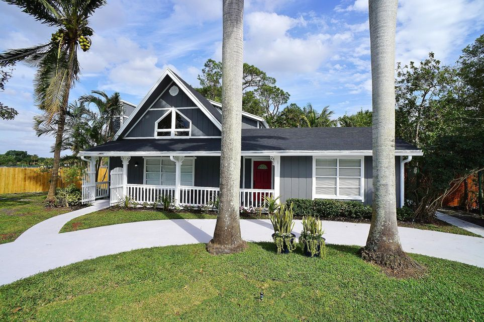 Casa Unifamiliar por un Venta en 1256 Palmetto Road 1256 Palmetto Road Haverhill, Florida 33417 Estados Unidos
