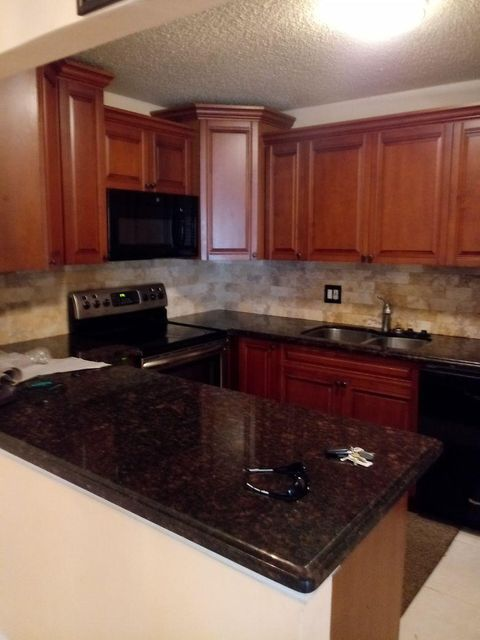 711 Sunny Pine Way B2 , Greenacres FL 33415 is listed for sale as MLS Listing RX-10402218 15 photos