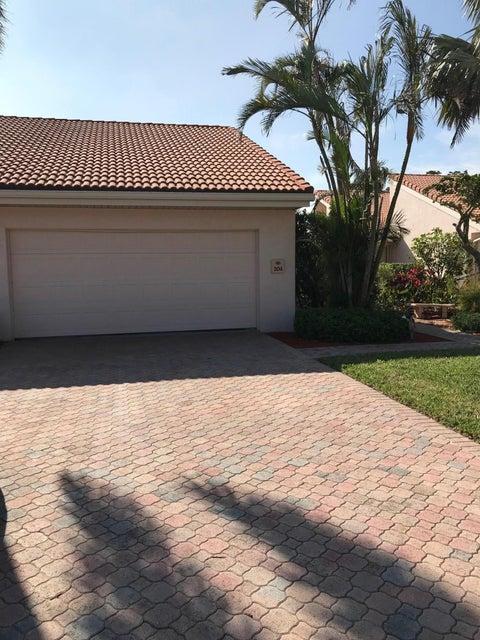 Кондоминиум для того Продажа на 19840 Sawgrass Drive # 204 19840 Sawgrass Drive # 204 Boca Raton, Флорида 33434 Соединенные Штаты